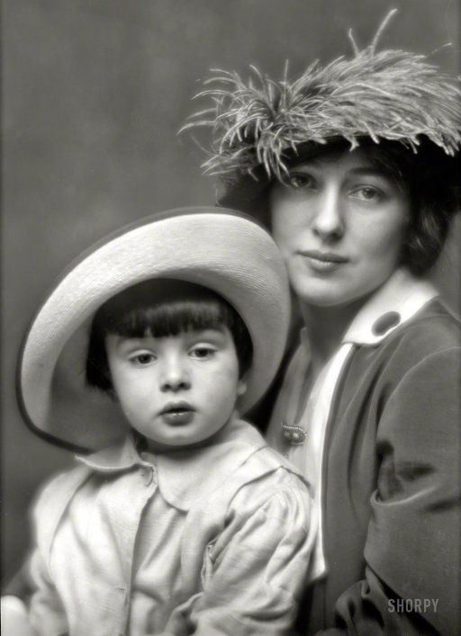 """New York, 1913. """"Mrs. Evelyn Nesbit Thaw and son."""" Photo by Arnold Genthe, whose serene portrait belies the intensity of the scandal that engulfed Evelyn when her husband killed her former lover, architect Stanford White, in 1906. While Harry Thaw denied paternity of the child raised as his son, Evelyn always maintained that Russell Thaw was conceived during a conjugal visit with her husband at Matteawan State Hospital for the Criminally Insane"""
