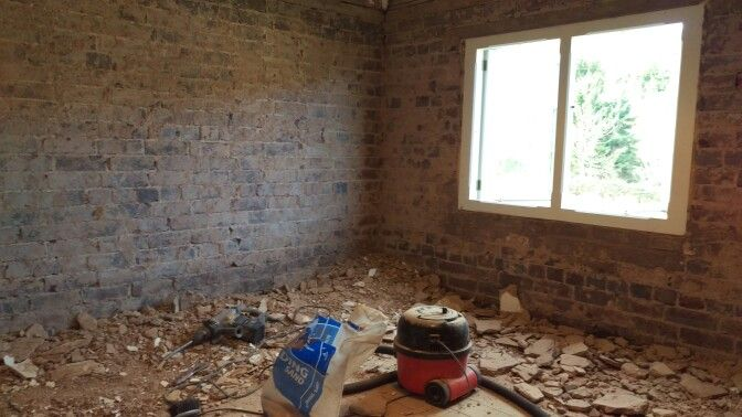 The old plaster and render has been stripped off the walls