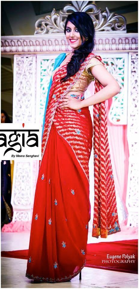 The red banarasi saree with a contrasting blue dupatta.