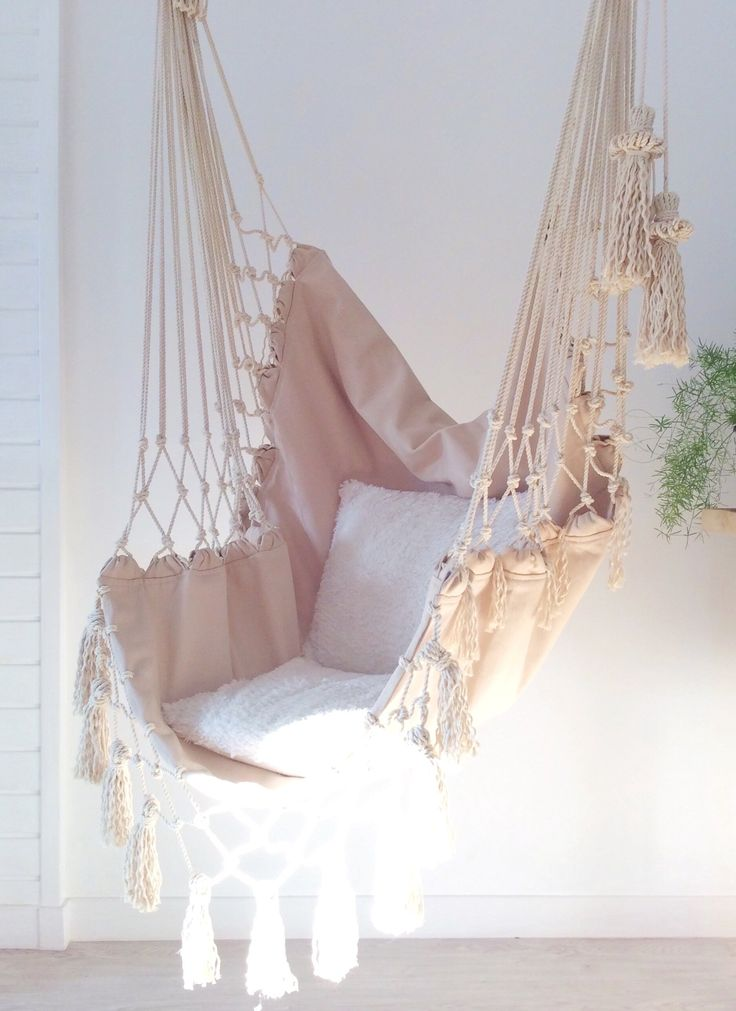 Universal Hammock. Hammock chair boho hammock. Rocking-chair of beige color with macrame, hanging ch