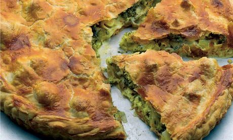 Ottolenghi's Broccoli + Gorgonzola Pie /  1 lb puff pastry  2 broccoli heads (1.5 lbs), cut into smallish florets  2 T butter  3-4 leeks, thinly sliced and thoroughly washed  2/3 c heavy cream  1/3 c water  1/3 c chopped chives  1/3 c chopped tarragon  3 T grainy mustard  1 t salt  7 oz gorgonzola  1 egg, beaten