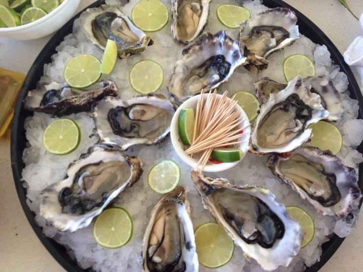 Viet Q Foods oysters with Lighthouse gin and lime!!