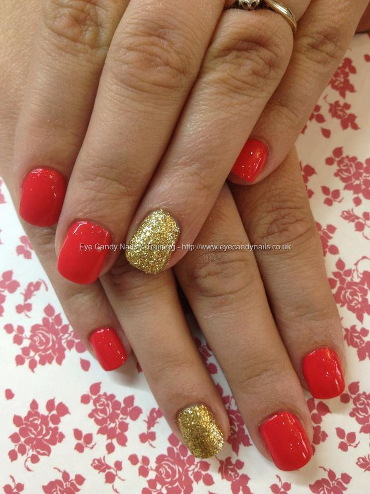 Coral+polish+with+gold+glitter+ring+finger+over+acrylic