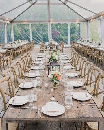 "Encourage mingling with a seating plan. A clear tent in The Foundry's courtyard housed this bride and groom's reception. Long, rectangular wooden tables and matching chairs were set up for dinner. ""It was important to us that everyone at the wedding—our close friends and family—felt like part of one big family during the reception, so we had barn tables arranged in long rows so everyone could meet and get to know each other and enjoy dinner together,"" says Cristina."