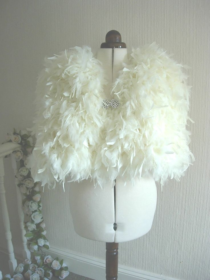 Handmade Chandelle Feather Bridal Shrug Winter Wedding Cape. $405.00, via Etsy.