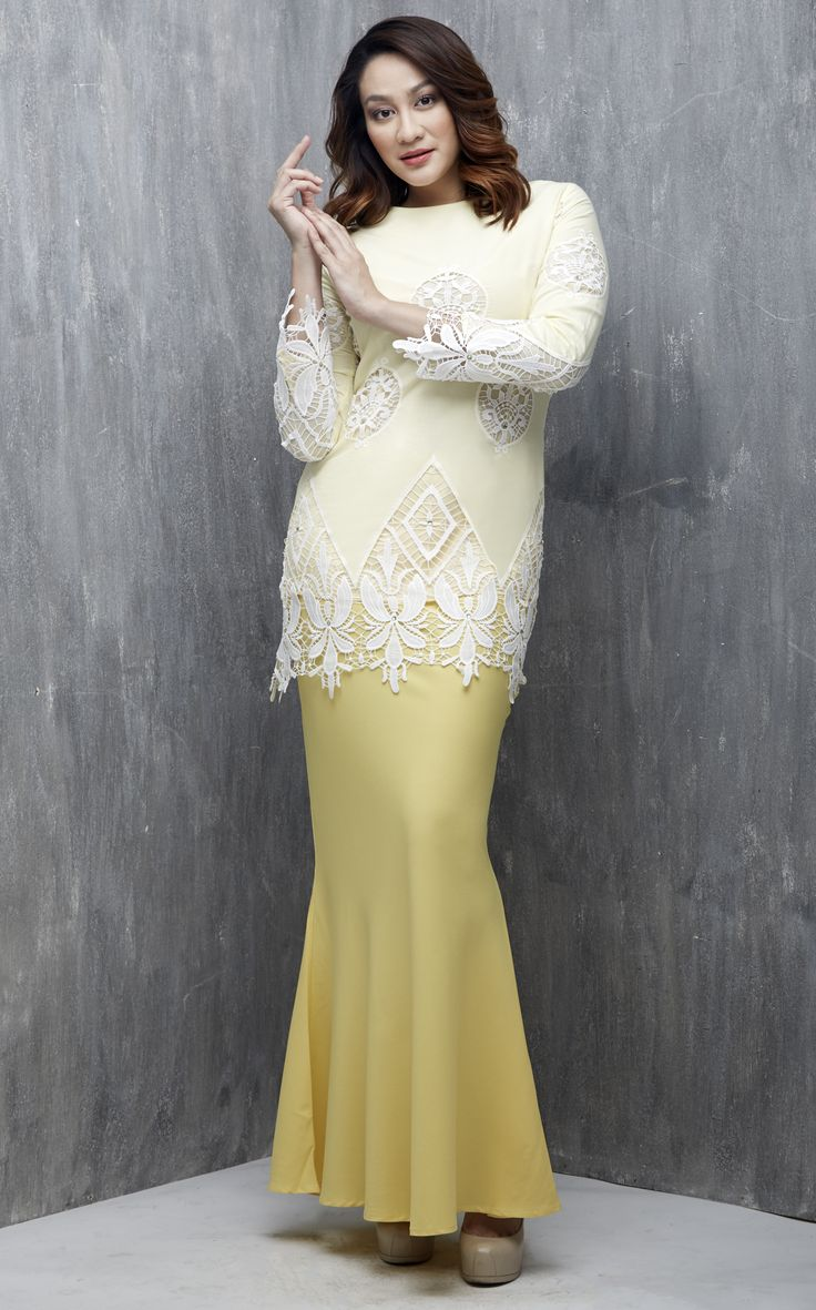 EMEL X DYNAS MOKHTAR - NOMADICA- Modern Baju Kurung with Lace (Yellow) This modern baju kurung is a statement piece for Raya. Features beautifuly embroidered and uneven detailing of lace on the bodice and sleeve with scattered matching coloured crystals. #emelxCLPTS #emelxDynasMokhtar #emelbymelindalooi #bajuraya #bajukurung #emel2016 #raya2016 #DynasMokhtar #lace #yellow #crystals