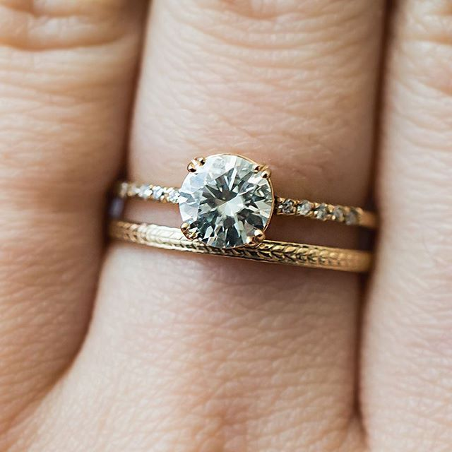 For a unique wedding band look, pair your engagement ring with a patterned band.