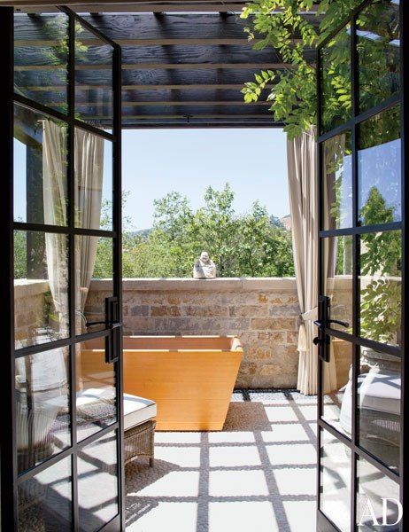 Gisele Bündchen and Tom Brady's Los Angeles HomeMaster Bath Terrace On the master bath terrace, curtains of a Perennials fabric can be drawn to shade a hinoki-wood tub