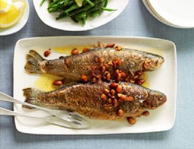 Ohrid Trout - Ingredients: 1kg. ohrid trout, 400gr. onion, 200gr. garlic, 80gr. oil, 200gr. crushed walnuts, salt. Preparation: Cut the gutted fish along its spine and put it on a barbeque. The finely chopped onion and garlic, together with the walnuts, oil and salt are fried and afterwards, the mixture is poured on the cooked trout. The meal is served with dry white wine