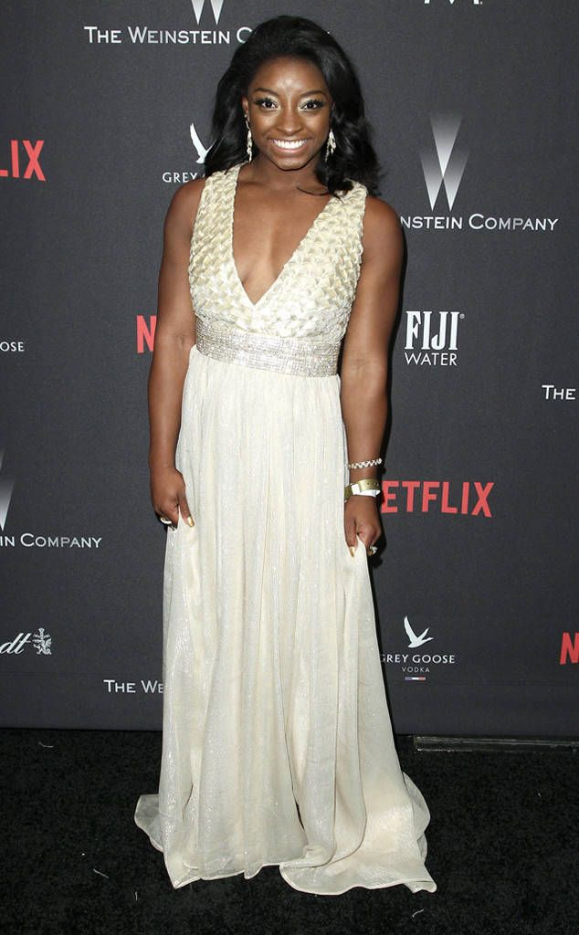 Simone Biles from Golden Globes 2017 Party Pics  The Olympic gold medalist picked a cream gown with a textured neckline for the Weinstein Company and Netflix after-party.