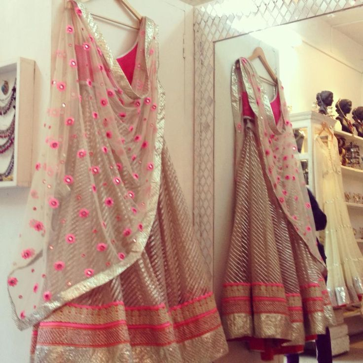 Price : 25,000 – 30,000 A beautiful off white and pink lehenga set. The skirt is made out of rich chanderi silk fabric with an embroided gotta patti border. A net dupatta and a pink silk blouse completes the look. This is prettinessss at its best! Store: Abhinav Mishra Delhi