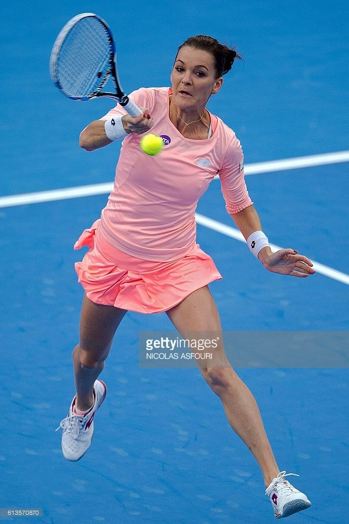 Agnieszka Radwanska of Poland hits a return against Johanna Konta of Britain during the women's singles final of the China Open tennis tournament in Beijing on October 9, 2016. / AFP / NICOLAS. Radwanska won the title 6-4, 6-2.