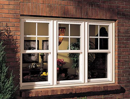 Three Milgard white Tuscany® Series Single Hung Vinyl Replacement Windows with top sash grids. View the before and after photos here: http://www.milgard.com/design-tips-and-inspiration/before-and-after/c/MMI10656/