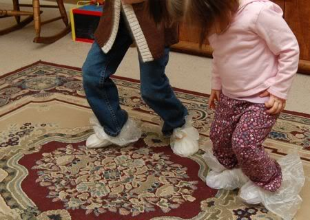 """Wrap wax paper around your feet with rubber bands to make """"skates"""", then dance to music!"""