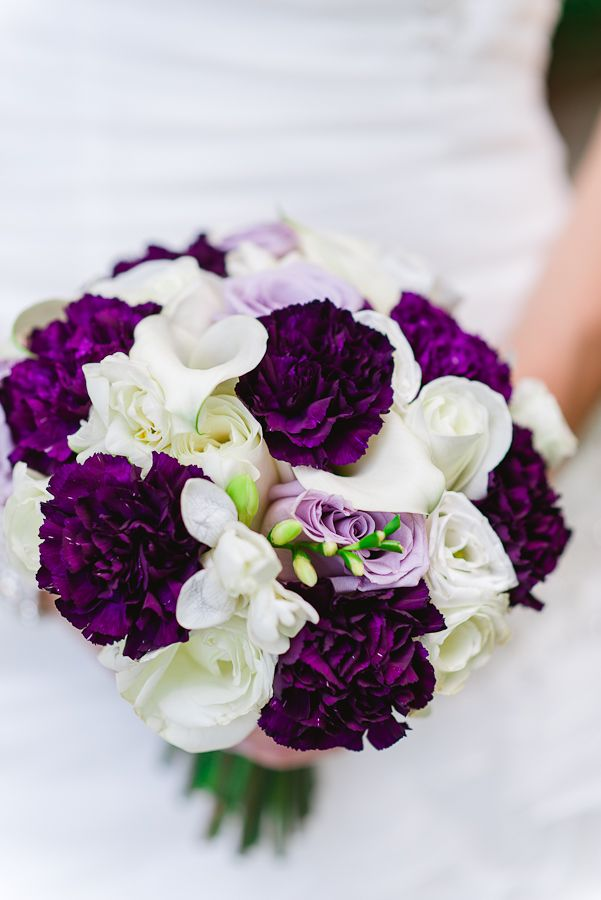"With so many brides on tighter budgets today, it's time to re-think (and re-invent) the carnation! These deep purple carns are from the very popular ""Moon"" series."