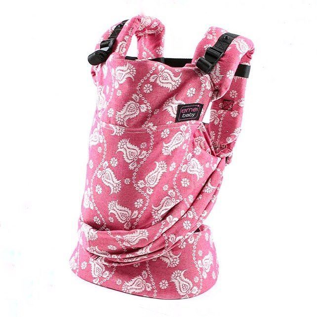 What a pretty paisley print just in time for spring . @emeibaby . . . [image of a barberry pink baby carrier with a white floral paisley pattern encompassing it. The design is called Paisley Barberry.]