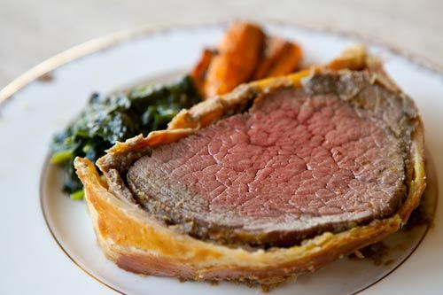 Beef tenderloin fillet, coated with mustard, mushroom duxelles, ham, wrapped in puff pastry        and baked. Based on Gordon Ramsey Beef Wellington recipe. ~ SimplyRecipes.com