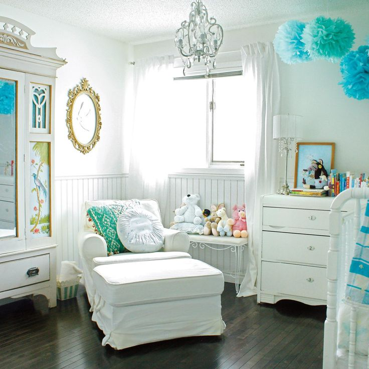 The white and blue of this nursery creates an elegance that will make all of the moms in your book club envious.