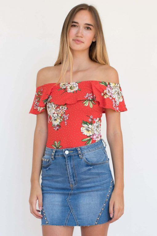 3bde21b439e6fc We re not ready to give up our summer prints!! This flirty flounce flower  bodysuit comes in red and navy!