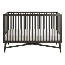 """Bring sleek style to your nursery with this handsome crib, crafted of beech wood and showcasing a midcentury-inspired silhouette.    Product: CribConstruction Material: European beech woodColor: EspressoFeatures:  Non-adjustable sides3-Position mattress supportNon-toxic finish Dimensions: 37.5"""" H x 53.5"""" W x 30"""" D Note: Mattress not included"""