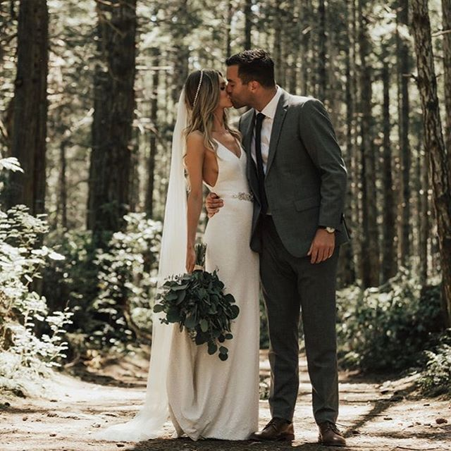 Truly, madly, deeply ✨ LOVE this simple silhouette of this chic dress paired with the long veil and head piece! Beautiful couple captured by @nomadbynk ✨ Tag someone you know who would love this! More dresses on our site, link in bio.
