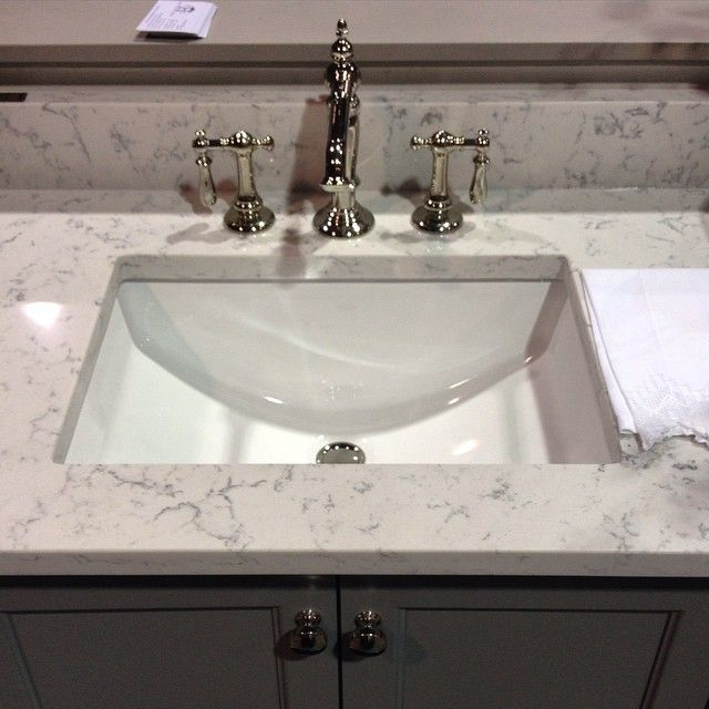 Photos Of Silestone uLyra u and a shiny chrome Kohler faucet from