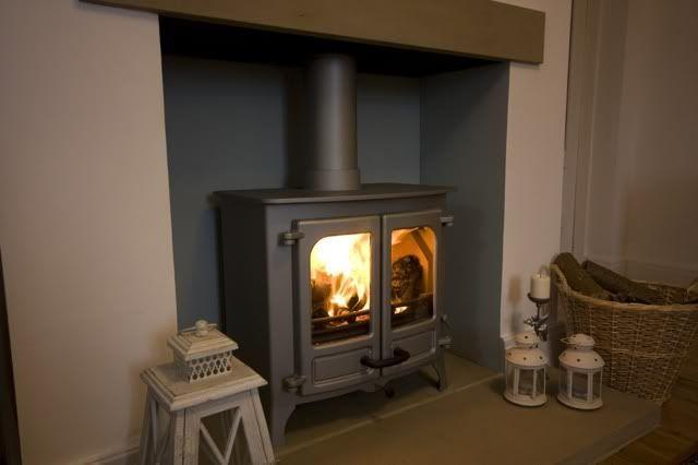 Large fireplace with log burner - grey / blue inside