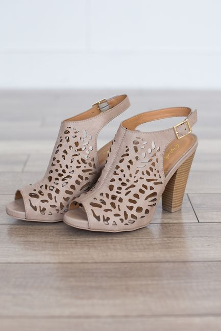 "Cutout detail slingback heels with a chunky stacked heel. Man made material. Heel measures 4"""" tall. Fits true to size. Style #SBAILEY-57TAUPE"