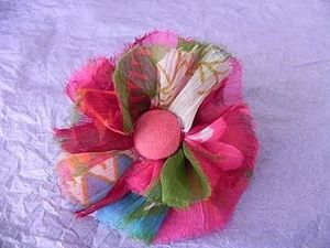 These fabric flower hairbands are pretty enough for a little girl, but chic enough for a fashionista.
