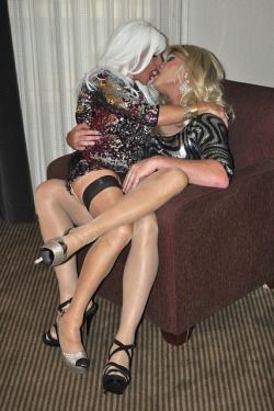 Absolutely sexy lesbian couple masturbates side by side on their living room couch 9