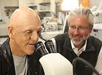 Michael Berryman, left, and Neil Shubin look at some fossils that shed light on the evolutionary origin of conditions known as ectodermal dy...