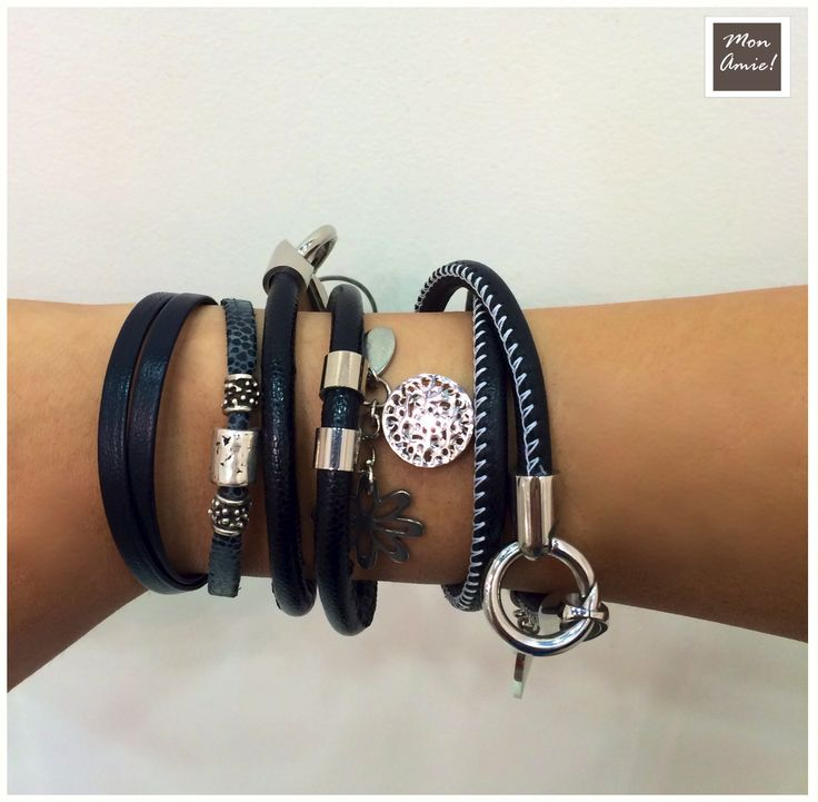 Very fashionable black bracelets with metal details
