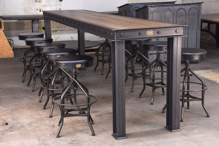 Base price includes a 96 x 40 steel top. Available in just about any size or finish... Shown with a natural steel finish and a reclaimed boxcar oak top. Optional tops: walnut, worn oak, mahogany, cherry