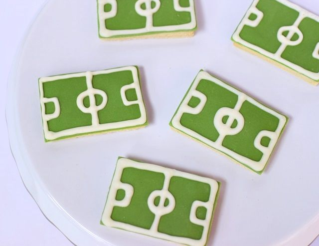 Football pitch biscuits - Cake Decor  Make these for sport lovers using ready to roll icing and Choco Writers!