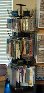 Clip It Up Knockoff ~ brilliant repurpose, use a spinning shoe rack from wm, hang supplies with clips...hmm, will take a look to see if this would work for my cling stamps, they would be so much easier to see than in the binders!