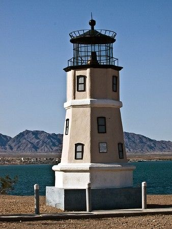 The U.S. state of Arizona is landlocked and mostly desert; navigation is limited to the lakes created by a series of dams on the Colorado River. One of these lakes is Lake Havasu, where the diligent members of the Lake Havasu Lighthouse Club have been building a series of lighthouses. These lights are reduced-size replicas inspired by famous lighthouses of the U.S. and Canada. The lights are legitimate aids to navigation, with designs approved by the Coast Guard and locations approved by…