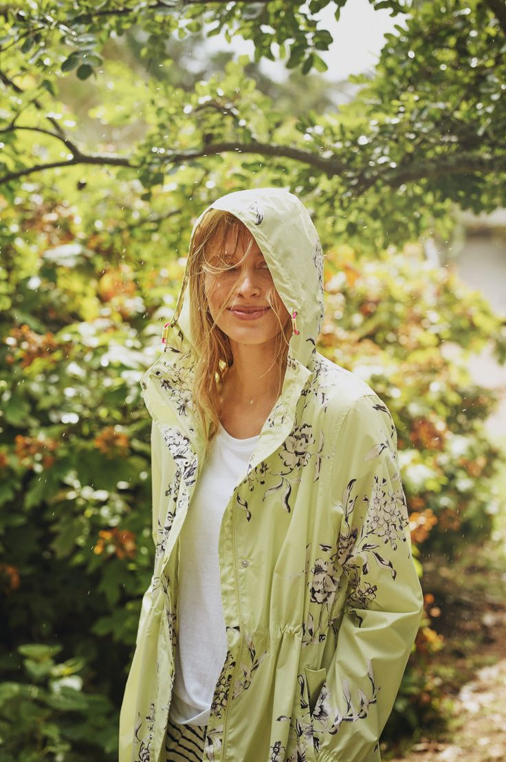 spring showers ready with this green floral raincoat
