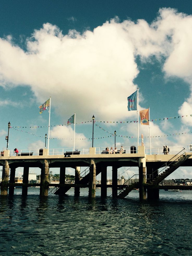 Falmouth's Prince of Wales Pier flying flags designed by our Textile Design students