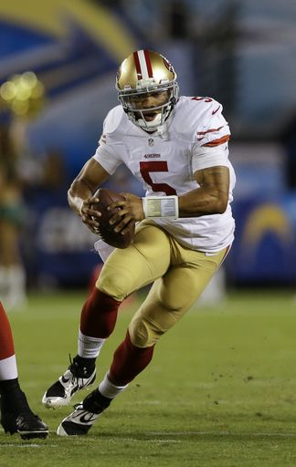 San Francisco 49ers quarterback B.J. Daniels runs upfield while playing the San Diego Chargers during the second half of an NFL preseason football game, Thursday, Aug. 29, 2013, in San Diego. (AP Photo/Lenny Ignelzi)