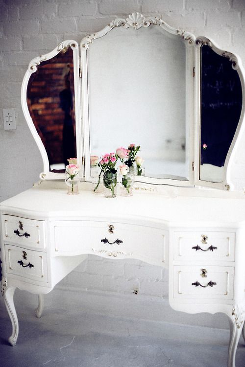 Vintage vanity is gorgeous. Wish I had a larger bedroom, I would so have one of these.