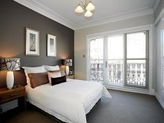 Master bed carpet And paint Bedroom inspiration: Dark feature wall to match dark carpet