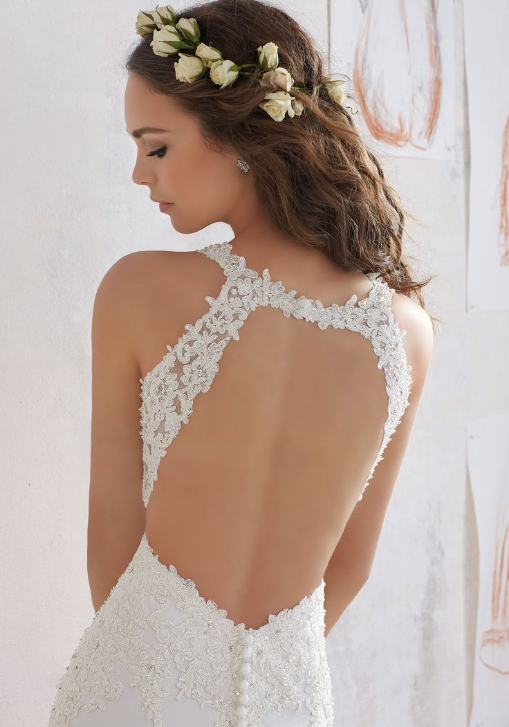 2017 Designer Wedding Dresses and Bridal Gowns. Classic Sheath Wedding Gown with Crystal Beaded Lace AppliquŽés that Accent the Bodice and Open Keyhole Back.