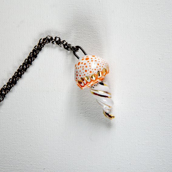 Orange gold jellyfish necklace.  This little jellyfish can't wait to swim around the world with you.  This item is 100% handmade high quality ceramics, glazed. Three times fired. Decorated with genuine gold. Comes with chain.