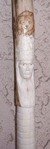 Hand carved walking stick of Paulownia, Indian and wood burned bear.