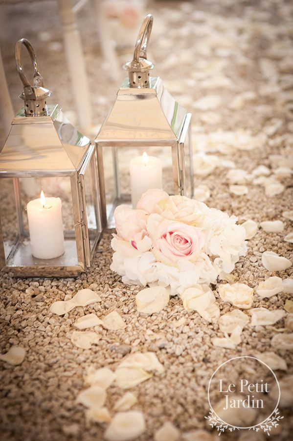 Silver lanterns and candles, and petals for an outside blessing