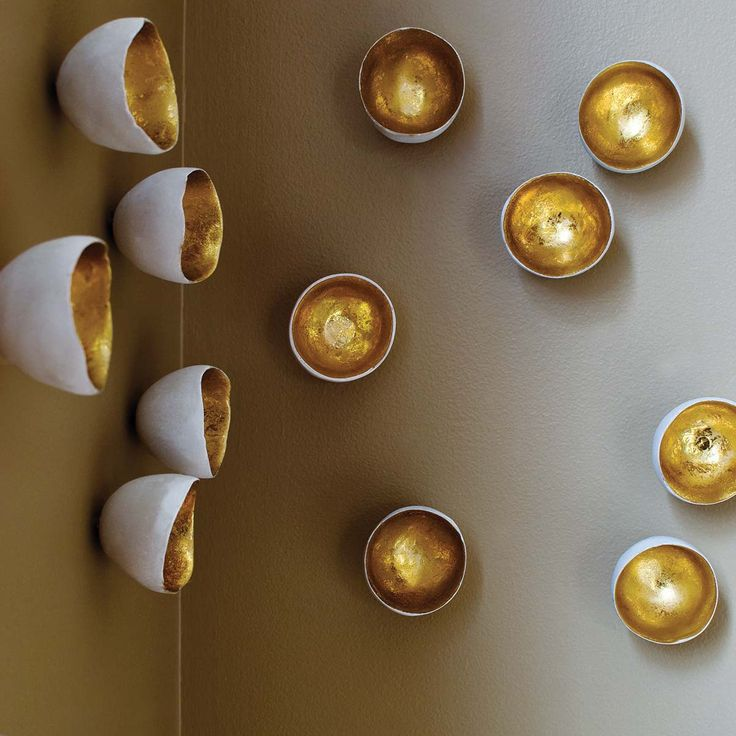 DIY idea - paint gold foil inside antique bowls and strategically arrange them on a wall to add instant artwork on an otherwise lackluster space! OR buy them for 63 dollars here