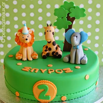 Zoo themed birthday party cake flavored with chocolate and strawberry mousse!