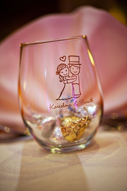 9 oz stemless wine glasses are available in 100's of design and color combinations.  Use them at dessert buffets for guests to hold their candy and then they can take them home as little favors.  Karishma & Barath chose this cute couple design.