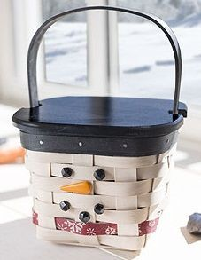 "2015 Mr. Flurry 4.75""x4.75""x4.25"" New   2015 whitewashed stain. Small Peg basket size and shape. Black trim strip. Center red splint with screened snowflake pattern. 1 black stationary handle. Includes 11-piece sticker set to create a face (2 small black eyes, carrot nose, 3 small black dots for mouth, 4 larger black dots for buttons). 2nd edition.  Available December 5 - 11, 2015 through an eCommerce special Black wood lid, tie on snowman accessories"