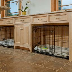 Instead of building in a pet crate, here, the cabinets are spaced in a way to provide nooks where crates can be tucked.